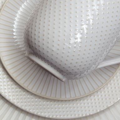 White Textured Stoneware Dinnerware (Set of 16)